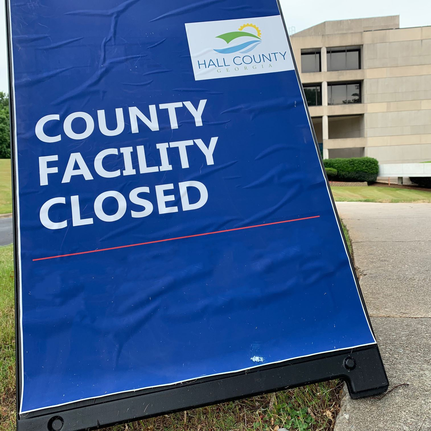 A closed sign outside the Hall County Government Center