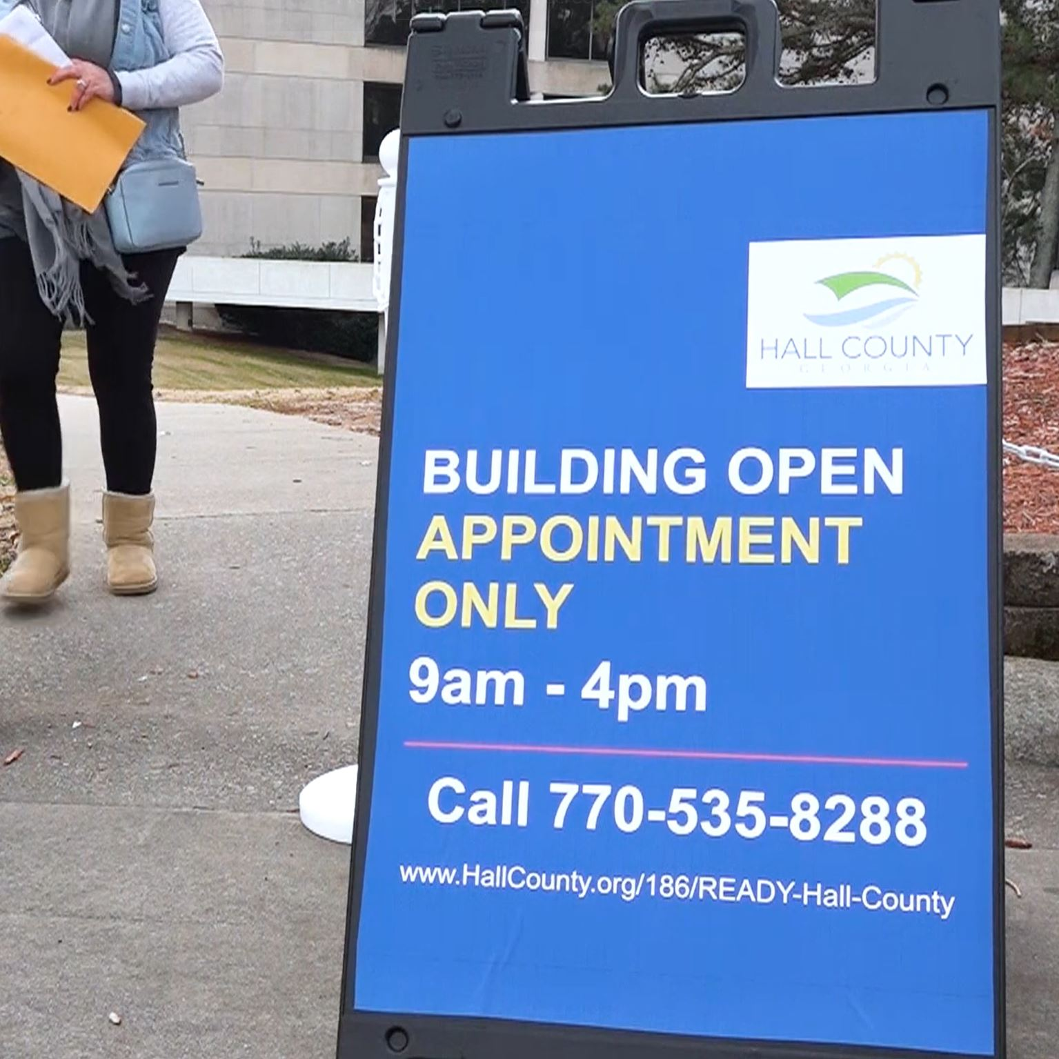 A sign indicating a building is open for appointments only.