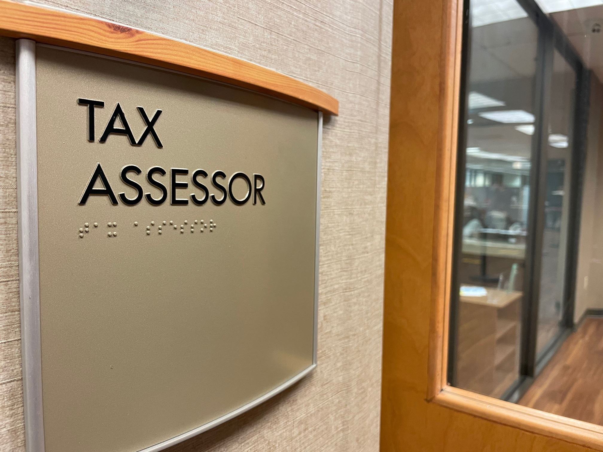 A sign for the Hall County Tax Assessor's Office